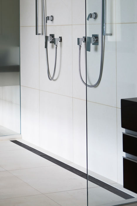 White bathroom shower with inscreed heating