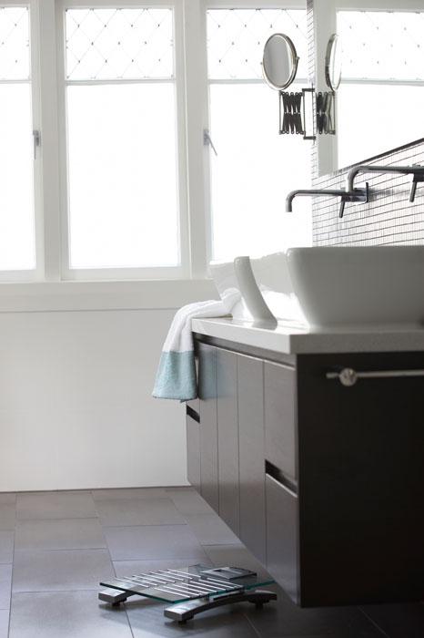 Bathroom sink area with inscreed heating