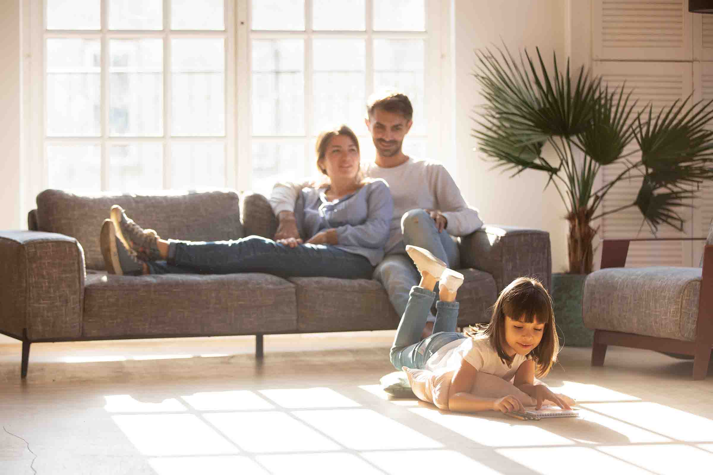 Family enjoying warmth on couch