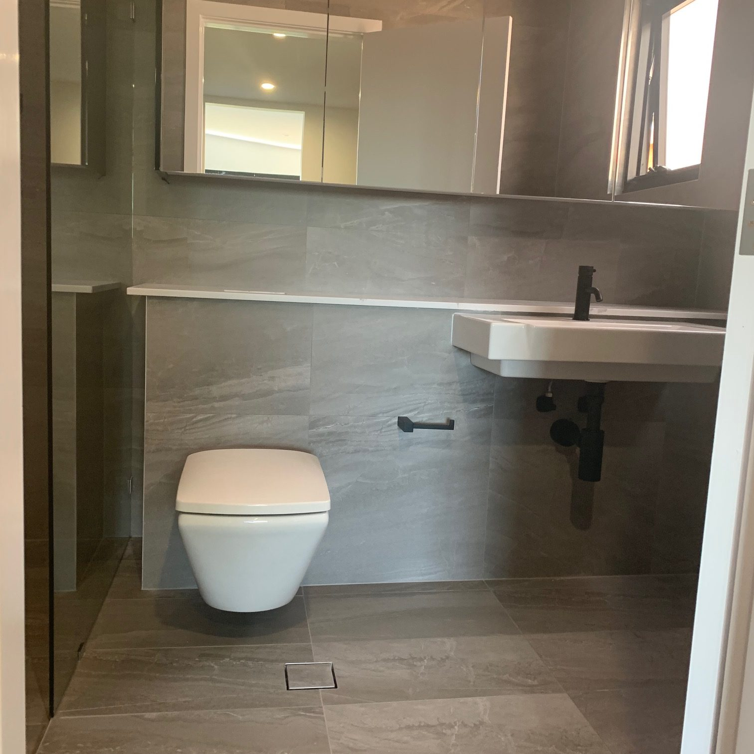 Bathroom sink and toilet area with Warmtech Inscreed heating system