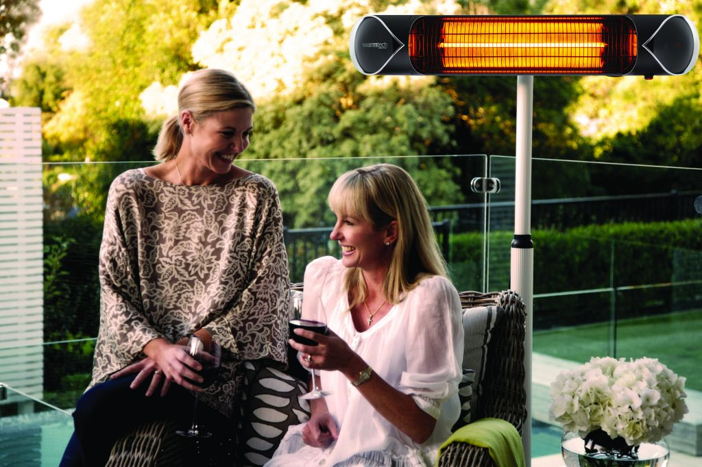 Ladies enjoying outdoor moderno heater