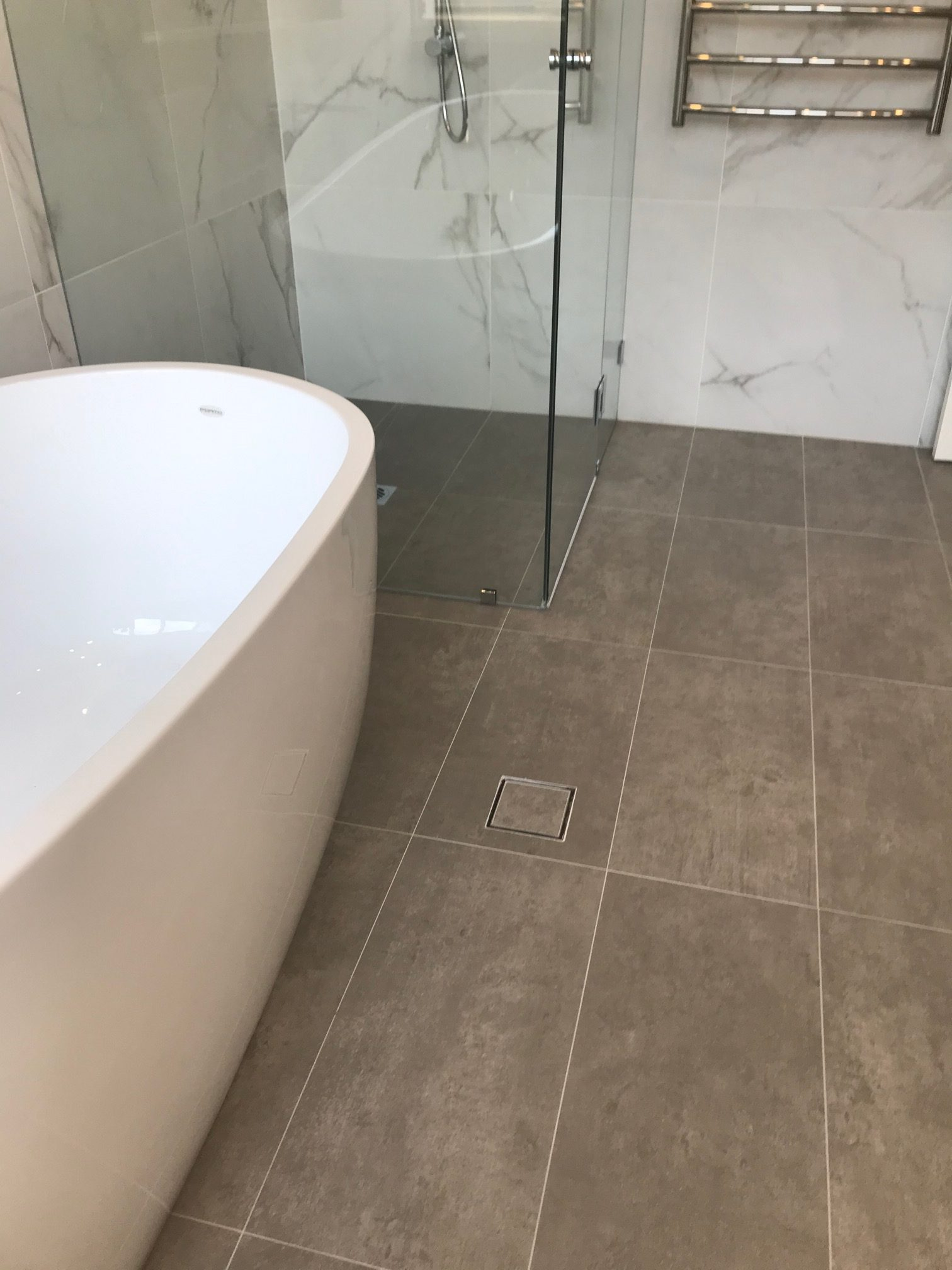 grey Marble bathroom floor with Warmtech Inscreed heating system