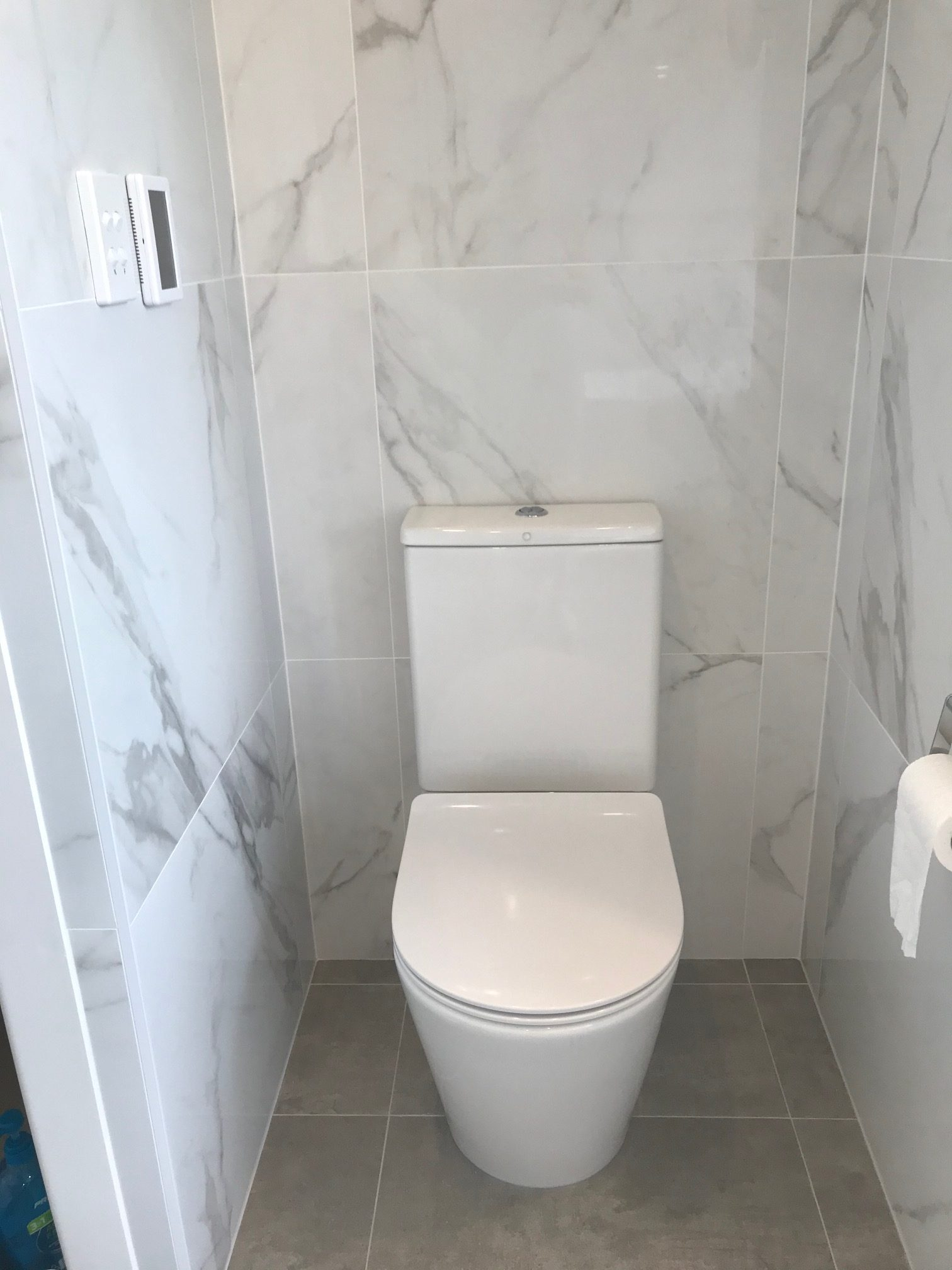 White Marble toilet area with Warmtech Inscreed heating system